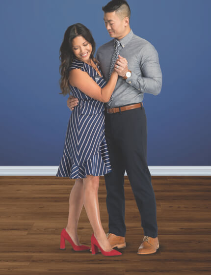 Couple dancing on coretec vinyl flooring | Gillenwater Flooring