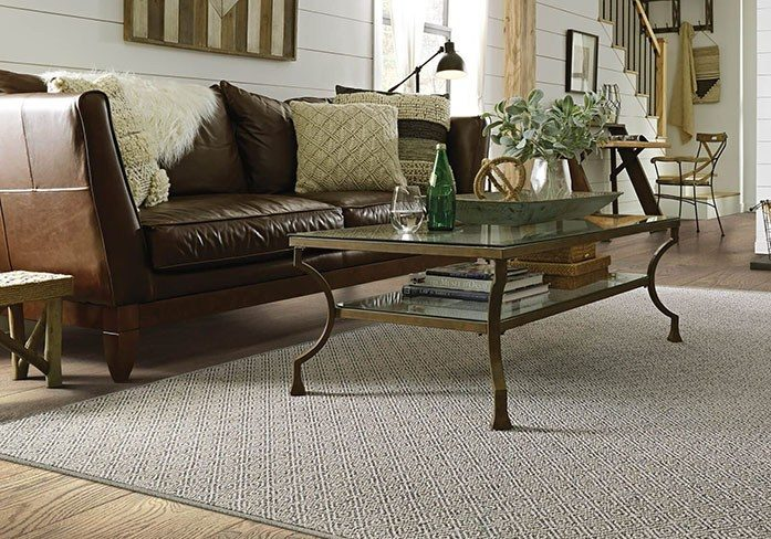 Sofa and coffee table on floor | Gillenwater Flooring